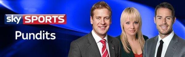Pundits Ed Chamberlin, Alex Hammond and Jamie Redknapp standing next to the Sky Sports logo.