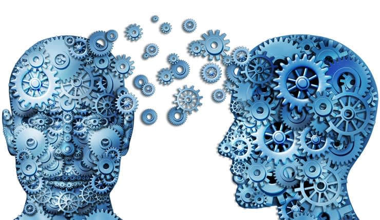 Trading psychology depicted by cogs working a brain.