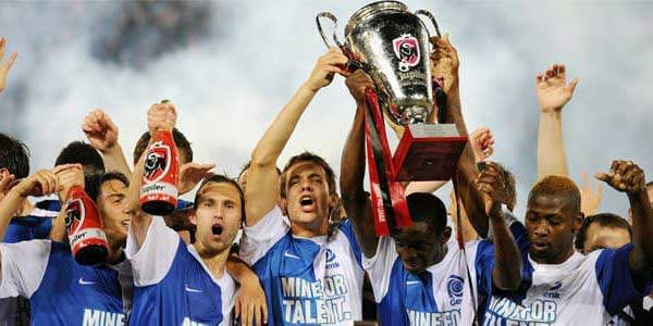 The Genk squad lift the Jupiler Pro League trophy after winning the 2010/11 title.
