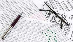 Betting slips, spectacles and a pen.