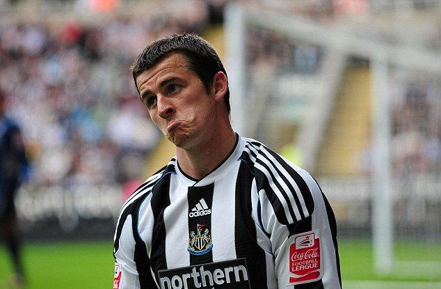 Joey Barton looks sad while playing for Newcastle United.