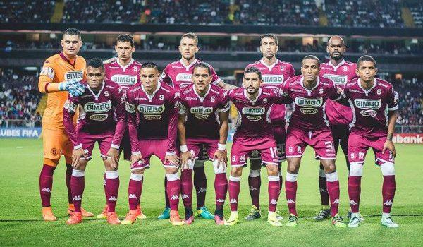 Deportivo Saprissa's squad line up for a team photograph.