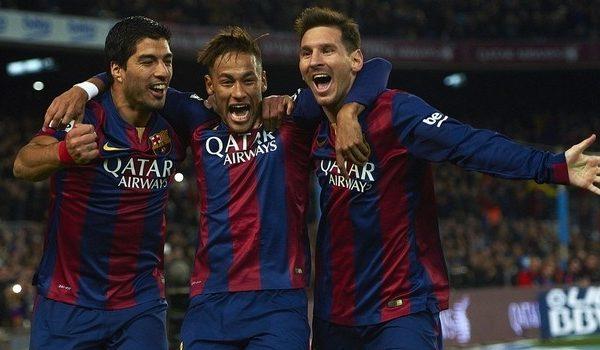 Luis Suarez, Neymar and Lionel Messi celebrate a Barcelona goal.