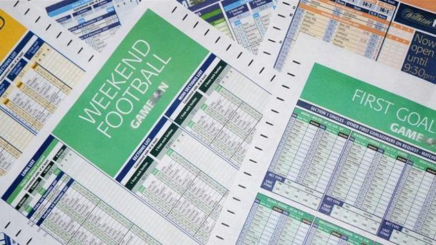 Football accumulator slips at a bookie.