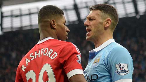 Martin Demichelis squares up to Marcus Rashford in the Manchester Derby.