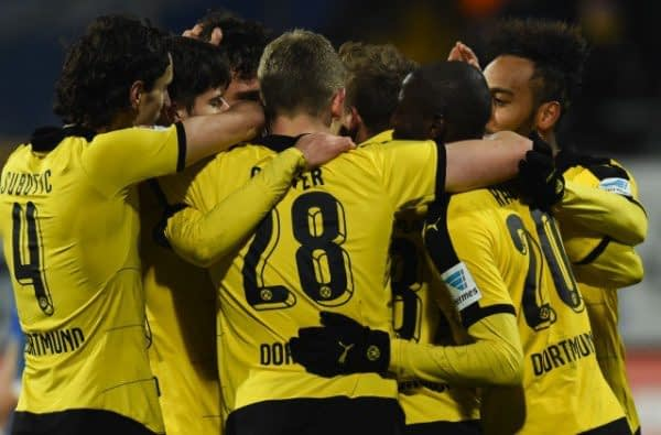 Borussia Dortmund celebrate after scoring in their 8-4 win over Legia Warsaw in the Champions League.