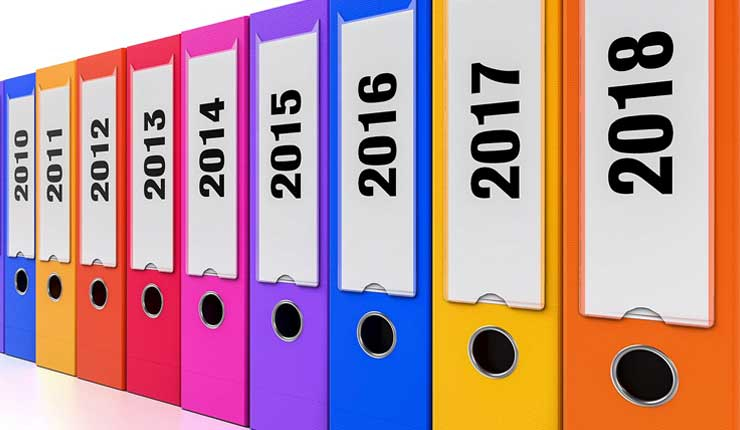 A row of folders numbered from 2010 to 2018