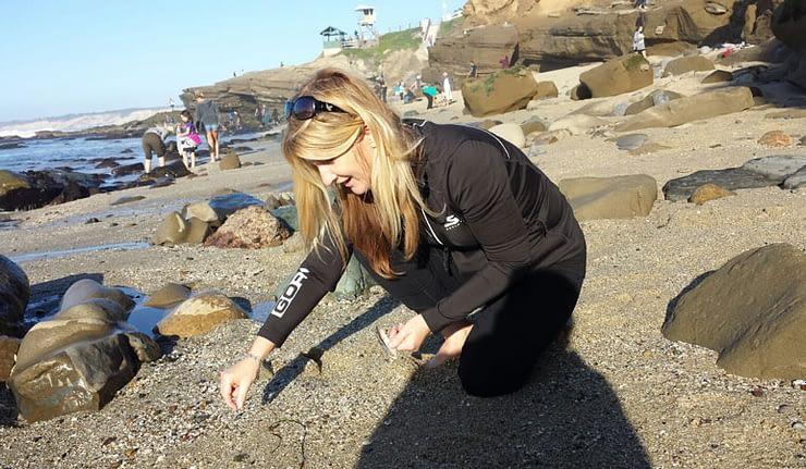 Looking for sea glass at Shell Beach, La Jolla, San Diego, California