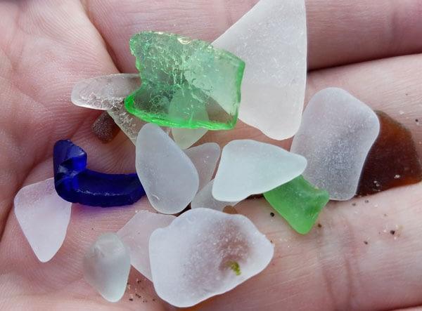 Handful of sea glass found on Alki Beach, Washington.