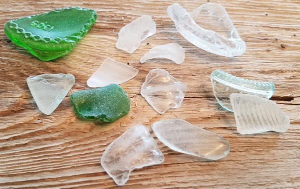 Pieces of green and clear sea glass found on the beach in Coupeville, Whidbey Island, Washington.