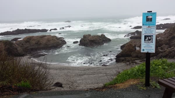 View of Glass Beach with warning sign to