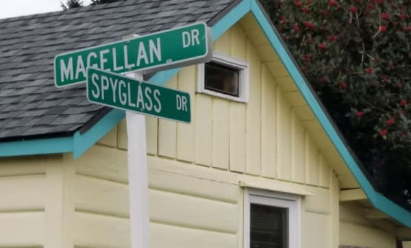Image of street sign showing the cross streets to the beach location of the semi private sea glass at Bush Point Beach on Whidbey Island, Washington.