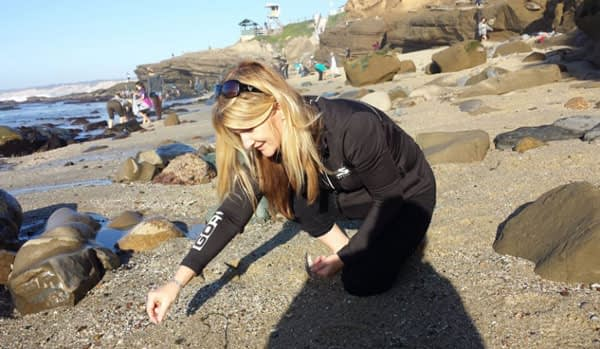 Jonna Marie collecting sea glass at La Jolla, San Diego