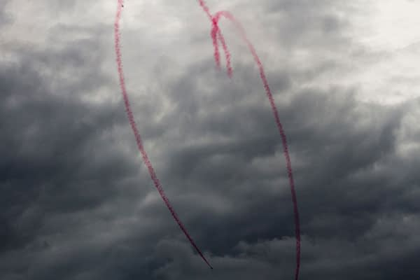 Red Arrows RAF jets at Bournemouth Air festival forming a heart with red smoke.
