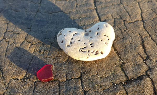 Red sea glass and heart shaped rock found at Southbourne Beach, Bournemouth