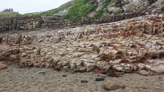 View of natural rock steps from Davenport beach up to the path to beach parking lot.