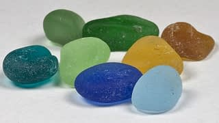 Blue, yellow, green, brown and aqua sea glass colors.