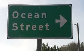 Ocean street sign on PCH. Only marker for parking lot that leeds to Davenport beach.