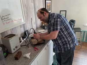 Gavin Hardy, making sea glass jewelry at Seaham Waves