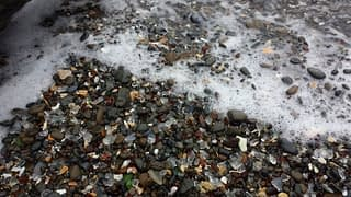Pacific ocean washing sea glass onto Glass Beach, Fort Bragg