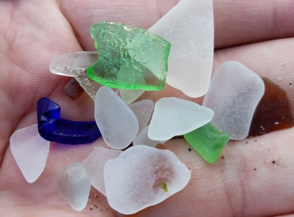 Handful of sea glass found on Alki Beach, Washington.