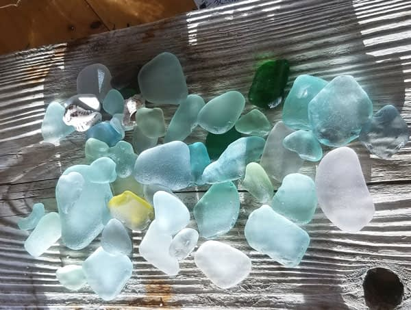 Sea glass pieces on wood