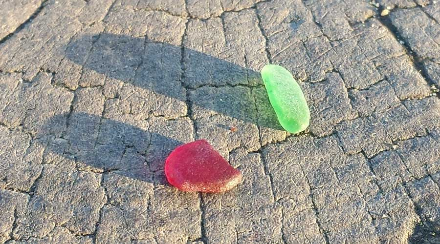 Green and red sea glass found at Southbourne Beach, Bournemouth