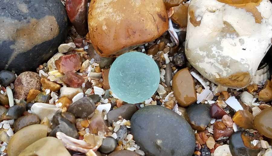 Aqua sea glass marble found at Minster-on-Sea, United Kingdom