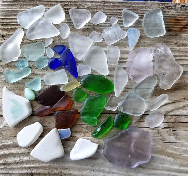 Blue sea glass and lavender sea glass Capo Beach, California