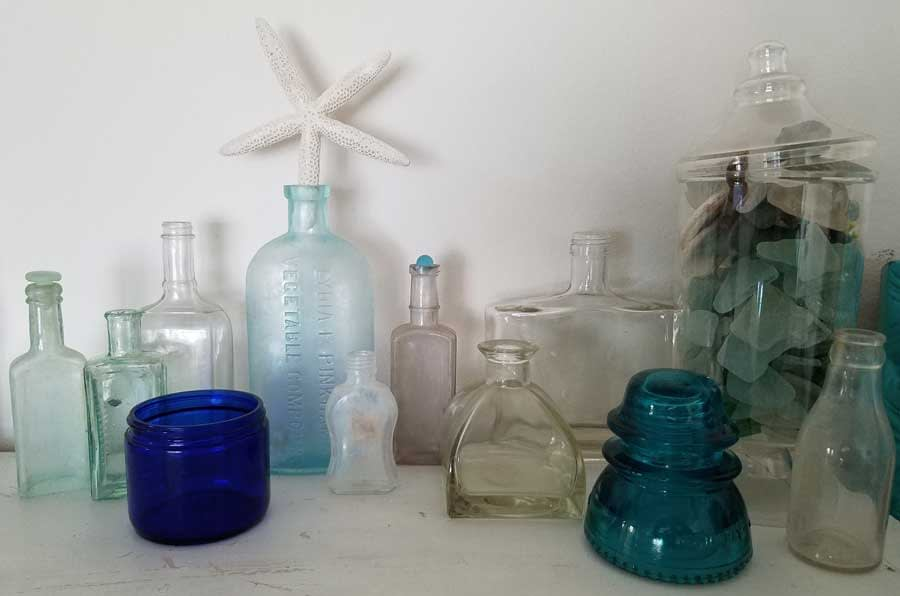 Collection of vintage glass bottles.