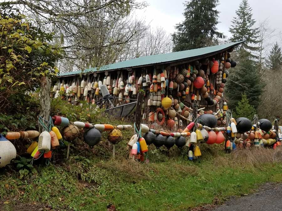 A barn covered with lobster pot floats and buoys in Forks, Washington