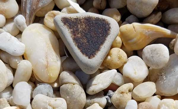Piece of brown wave tumbled sea pottery.