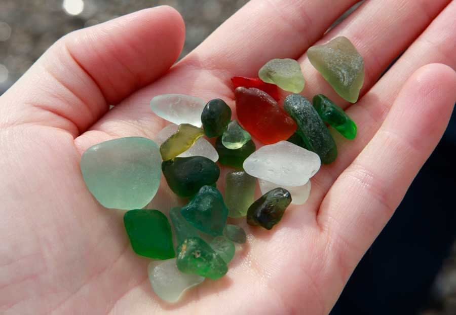 Sea glass held in the palm of a hand