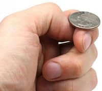 Man about to flip a coin.