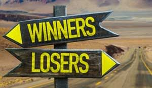 "A road sign pointing the way to ""Winners"" and ""Losers""."