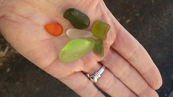 hand full of Capo Beach sea glass orange green lime green