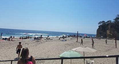 View of ocean, beach umbrellas and rocks at Victoria Beach, Laguna Beach.