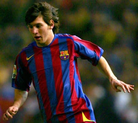 A young Lionel Messi dribbles the ball while playing for Barcelona B.