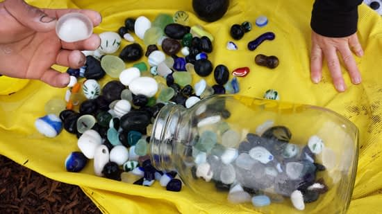 Large mason jar full of large smooth round pieces of art sea glass from Davenport Beach. Glass remnants from Lundberg Studio worn smooth from years of tumbling in the surf.