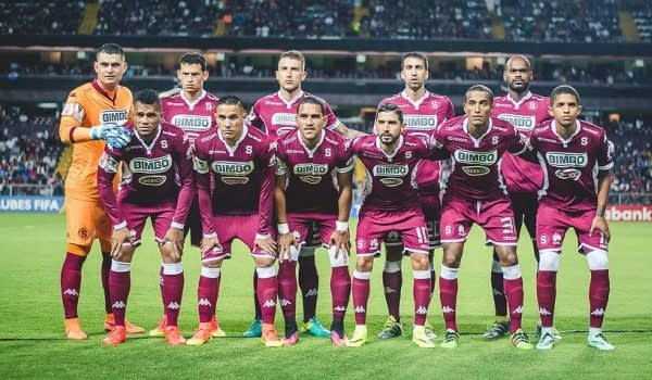 Deportivo Saprissa's squad line up for a team photograph.