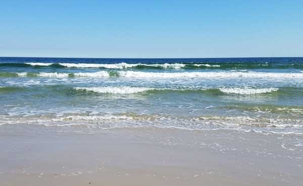 Blue sky and waves on Long Beach Island, New Jersey.