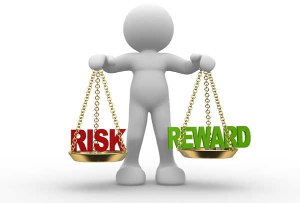 "Scales balancing ""Risk"" and ""Reward""."