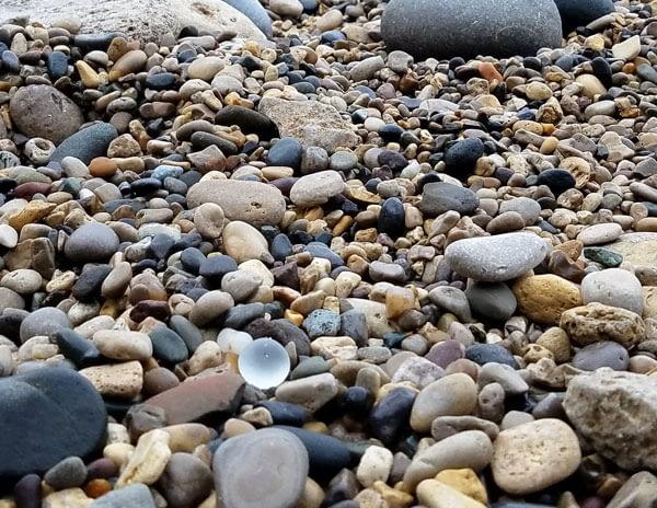 Wave tumbled sea glass bauble resting on Ryhope Dene beach.