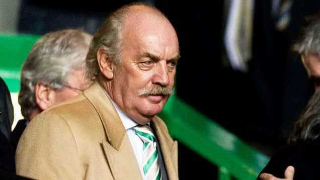Shareholder Dermot Desmond stands in the crowd at a Celtic FC match.